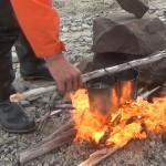Попробуйте этот способ розжига костра в сильный ветер  с поддувом